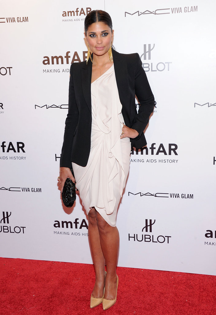 Rachel Roy topped a structured black blazer over a white one-shouldered cocktail dress. Her croc-print pumps offset the tailored look above.