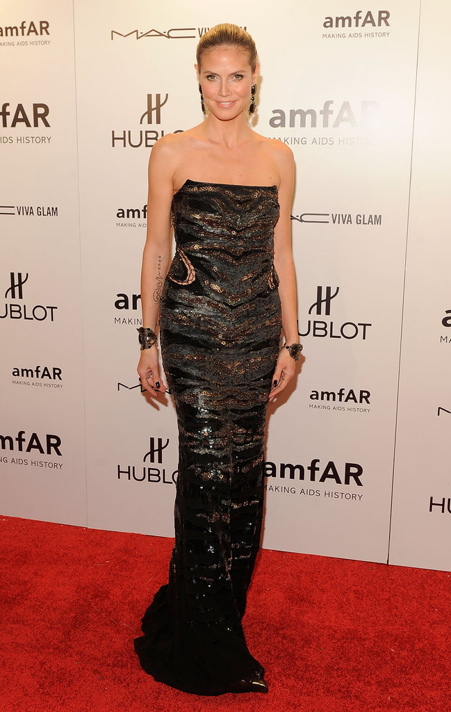 Heidi Klum slipped into a metallic strapless.