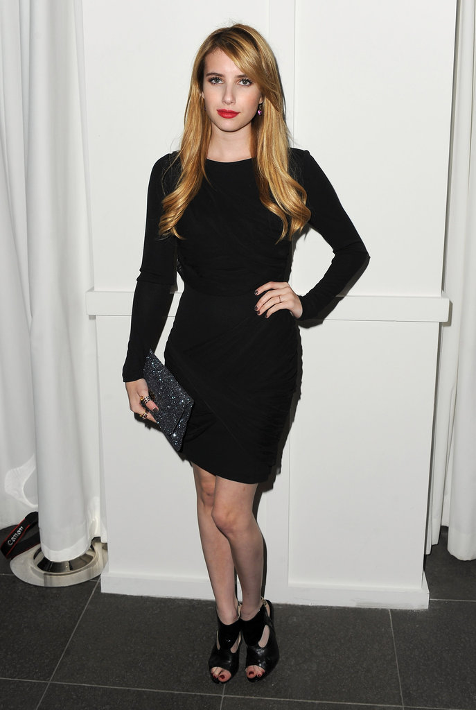 Emma sported a sultry LBD and cutout booties for the Hype Music Awards in August 2011.