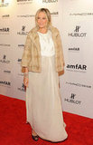 Molly Sims topped her ethereal white gown with a furry jacket.