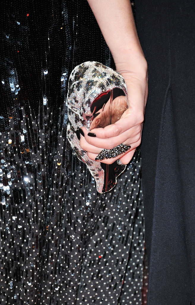 Diane complemented the look with a sequined Judith Leiber clutch, dark nails, and a bold cocktail ring.