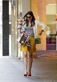 Miranda Kerr had her hands full with Flynn Bloom.