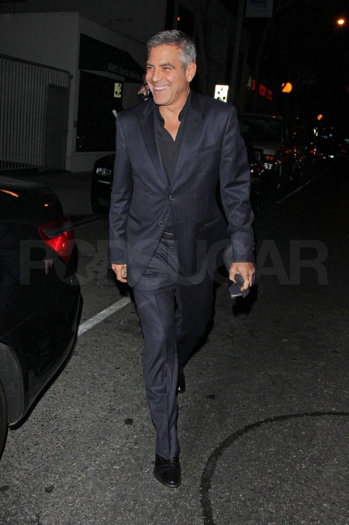 George Clooney wore a suit out to dinner.