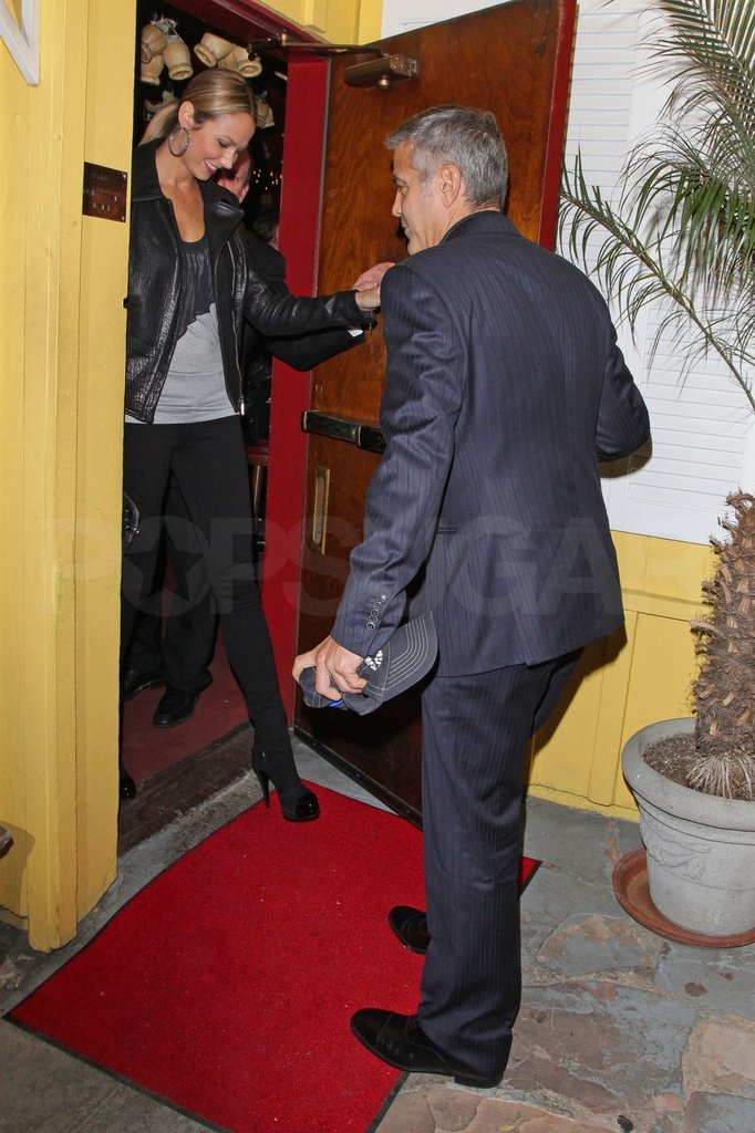 George Clooney held the door for Stacy Keibler.