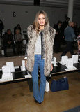 Olivia Palermo took her styling skills to the front row of Peter Som in a furry vest and high-waist denim.
