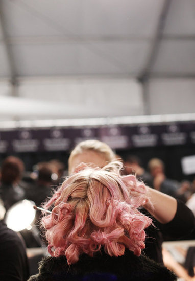 A pretty-in-pink model has her makeup done. Photo: Roger Kisby