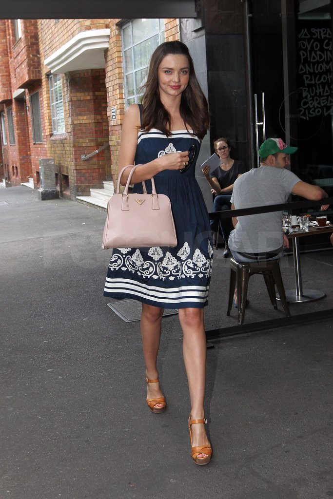 Miranda Kerr carried a pink Prada bag.