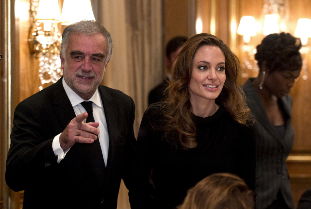 Angelina Jolie joined a prosecutor at the International Criminal Court at a workshop in Berlin.