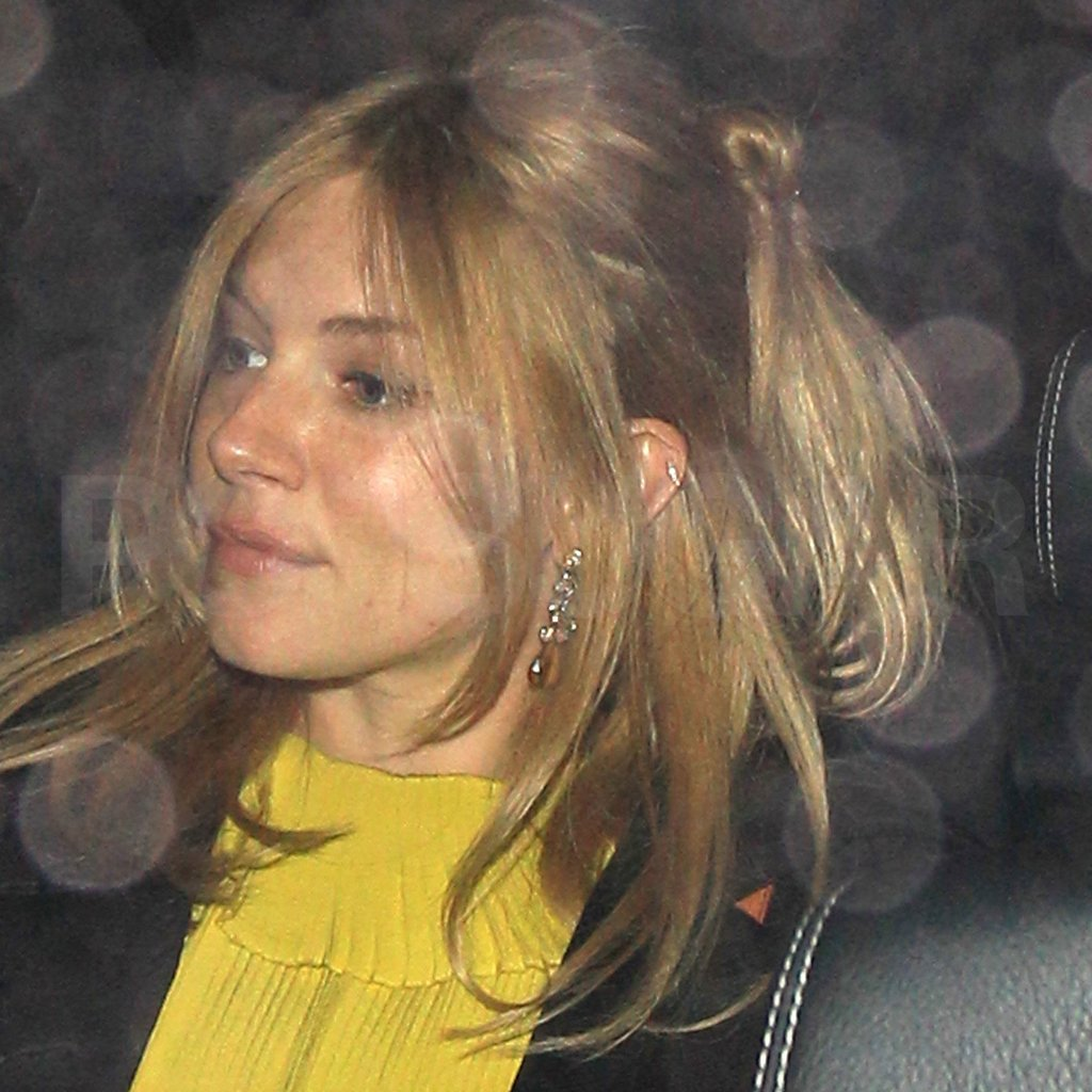 Pregnant Sienna Miller left a club in London.