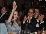 Angelina Jolie waved to fans while Brad Pitt and the rest of the audience applauded her.
