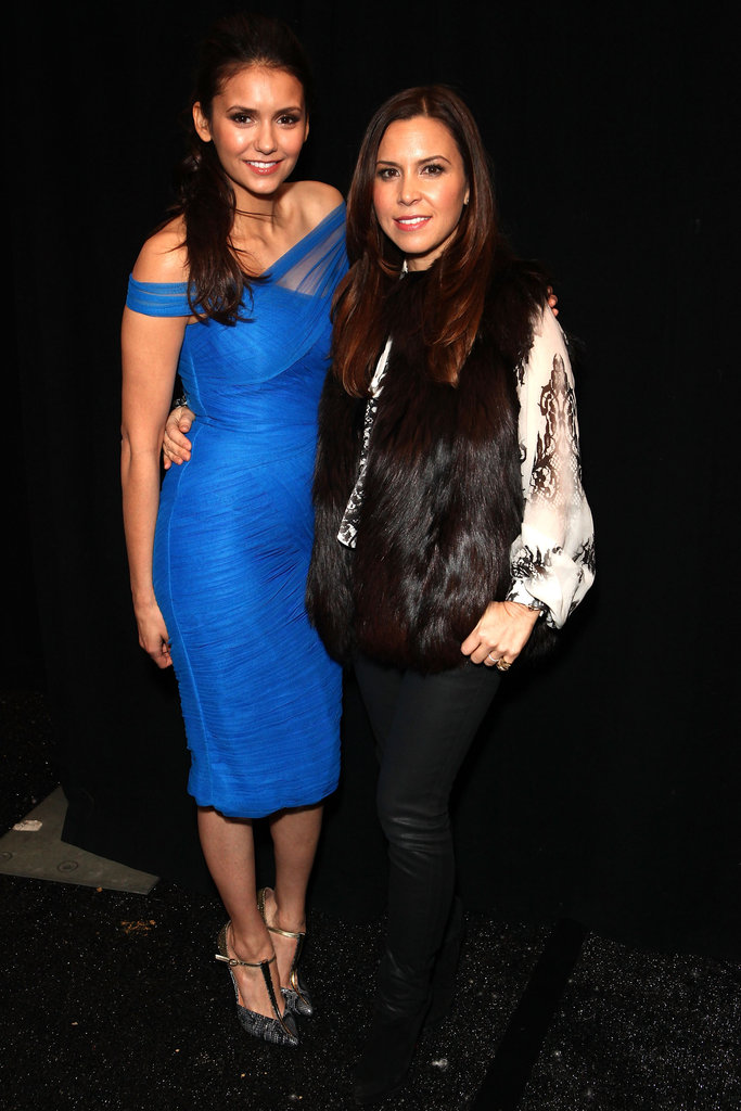 Nina Dobrev chatted with Monique Lhullier at the designer's runway show.