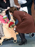 Kate Middleton greeted a child.