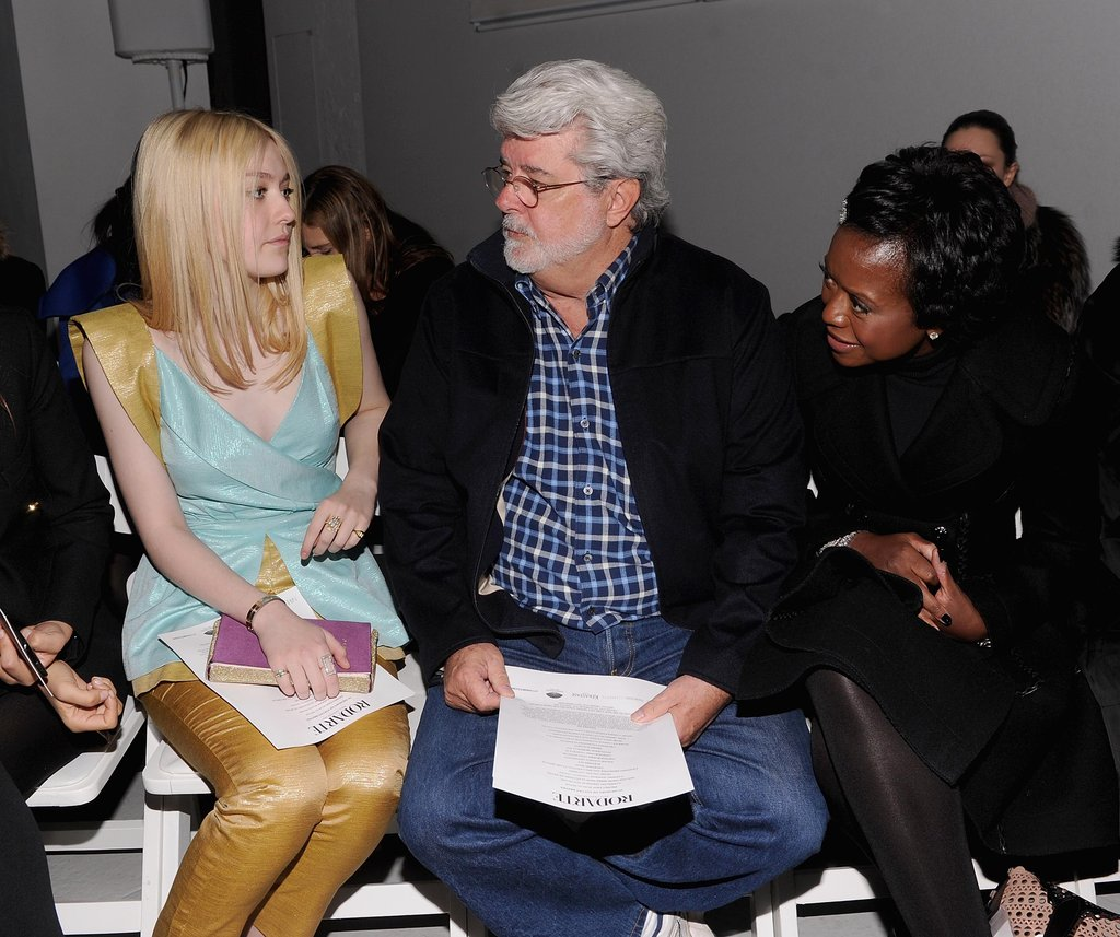 Dakota Fanning and George Lucas in the front row at Rodarte.