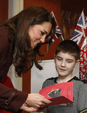 Kate Middleton receives a Valentine's card from Ethan Harris as she visits Alder Hey Children's Hospital in Liverpool.