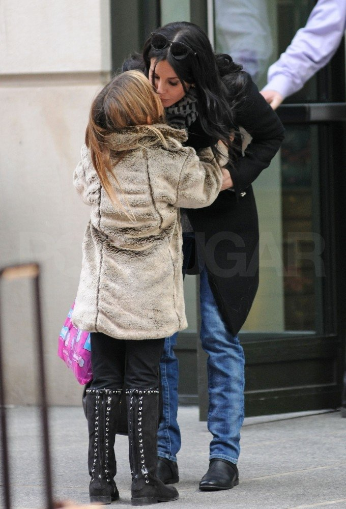 Courteney Cox gave her daughter Coco a kiss in NYC.