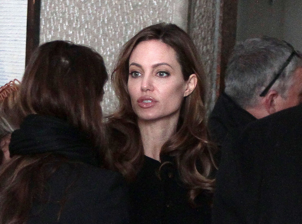 Angelina Jolie talked with friends in Bosnia.