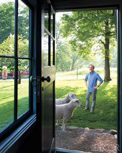 Owner and interior designer Richard McGeehan poses next to a pair of sheep at his Wisconsin home. Read more about this lovely spot on Elle Decor.  Source