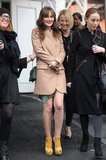 Leighton Meester, also at Fashion Week, carried her emerald Bulgari chain-strap bag with a printed dress, camel coat, and yellow booties.