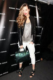 Petra Nemcova's metallic green satchel added major pizazz to her ensemble at the Diesel Black Gold show at NYFW. Shop her look here.