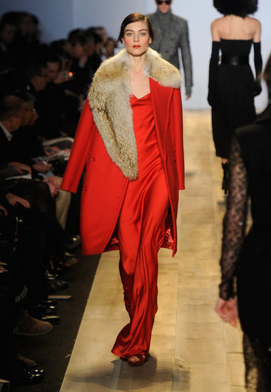 Siren red on a coat, with fur. Ultra Michael Kors.