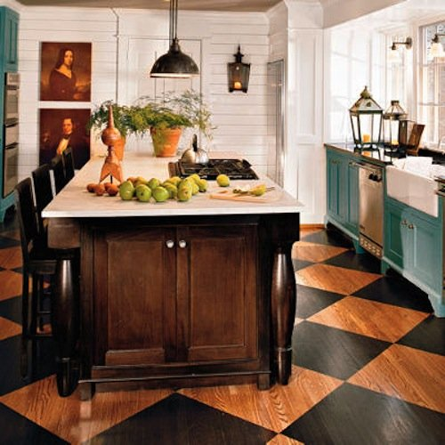 A classic country kitchen is reinterpreted with a modern color palette and stenciled floor.  Source