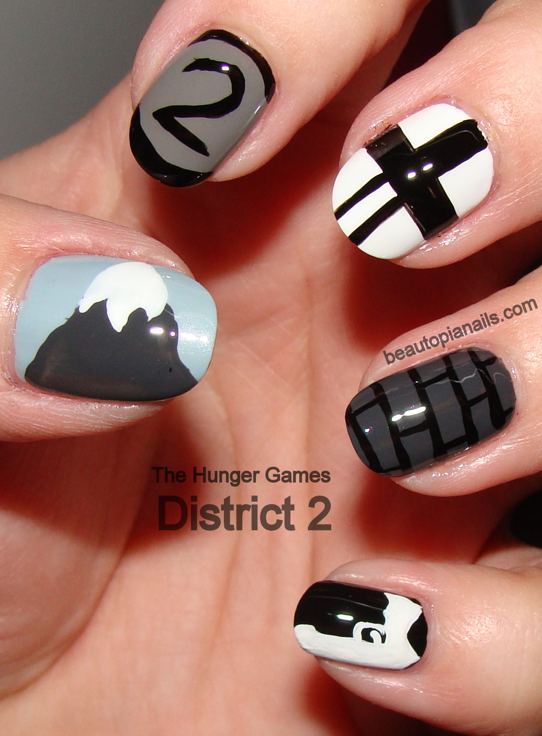 ... my hunger games nail art series i did nails based on district 2 in the