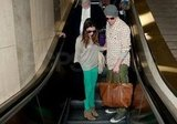Channing helped Jenna navigate the escalator.