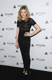 Chloe Moretz paired a black lace top with slim black trousers and sexy black lace-up heels.