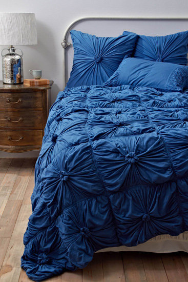 Winter blues don't have to necessarily be a negative thing. Embrace the hue with this cozy-looking Rosette Quilt in New Blue ($150).
