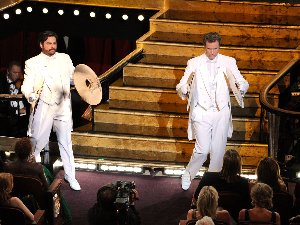 Zach Galifianakis and Will Ferrell hit the stage with cymbals.
