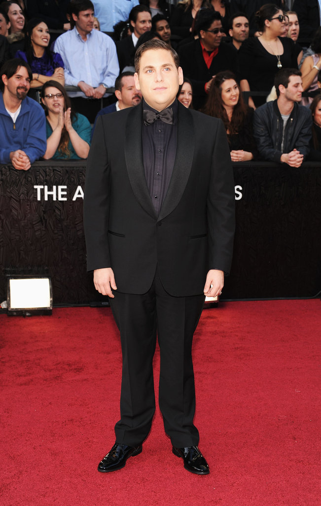 Jonah Hill posed solo on the Oscars red carpet.