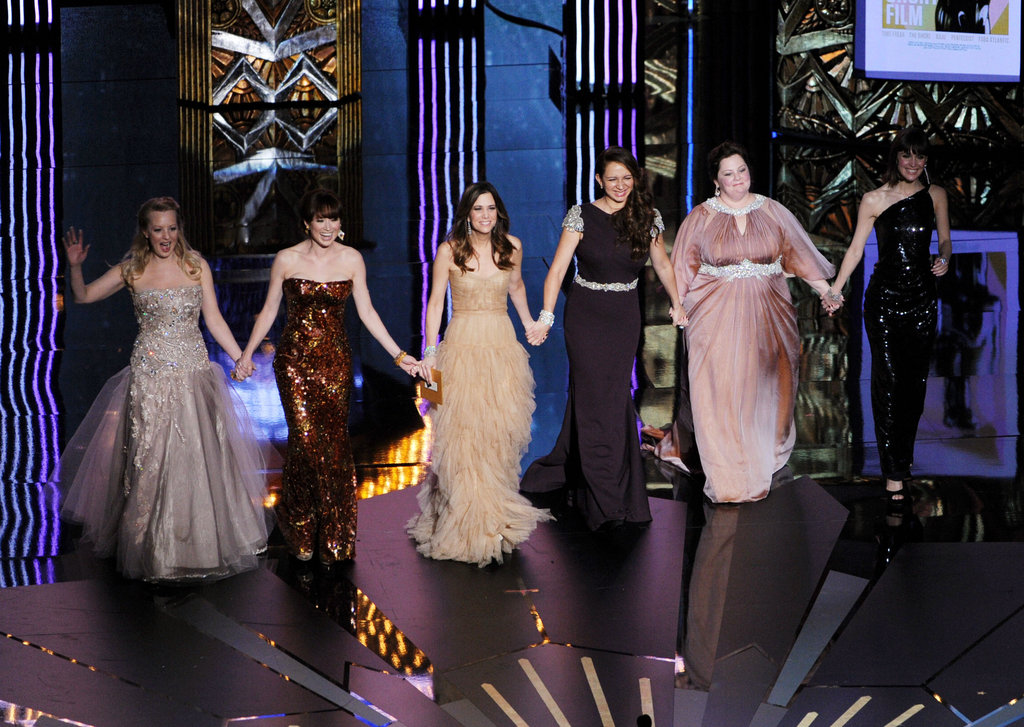 The ladies of Bridesmaids walked onto the stage holding hands at the 2012 Oscars.