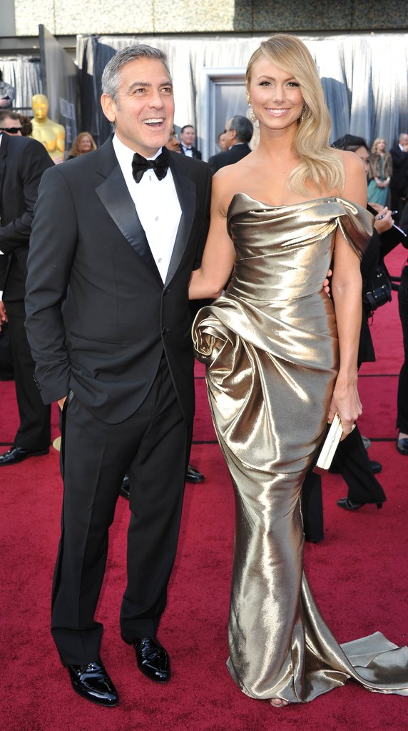 George Clooney and Stacy Keibler having fun on the Academy Award red carpet.