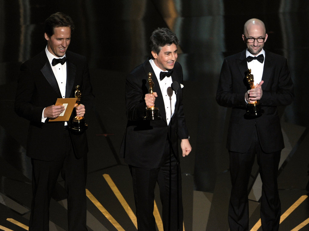 Screenwriters Nat Faxon, Alexander Payne and Jim Rash accept the Best Adapted Screenplay Award for The Descendants at the 2012 Oscars.