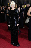 Anna Faris contrasted her blonde bob with a black sequined long-sleeved gown. Do you like her edgy red carpet look?