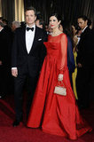 Colin Firth and wife Livia Giuggioli made a handsome duo — Colin in a classic tux and Livia in an elegant red gown.