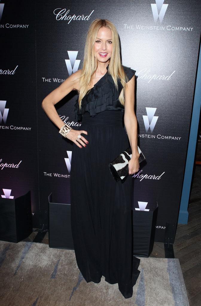 Rachel Zoe went for a glam one-shoulder ruffled dress and a graphic clutch.