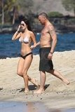 Brian Austin Green and Megan Fox held hands walking to the water.