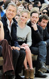 Kate Bosworth smiles while seated front row at New York Fashion Week.
