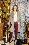 Alexa Chung donned a furry jacket, red trousers, and a silky blouse to the Mulberry dinner party.