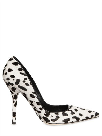 Exotic prints aren't going anywhere, so stock up on the wild trend in a classic shoe silhouette. Dolce & Gabbana 110mm Leopard Printed Pump ($539, originally $770)