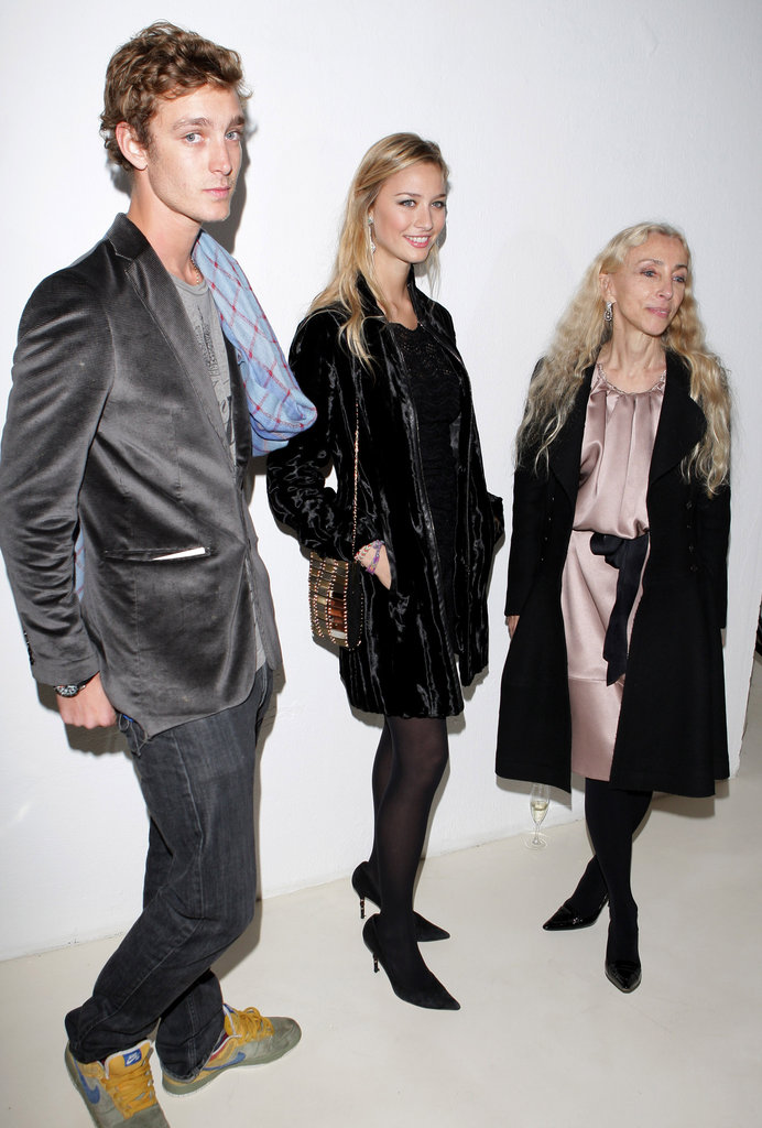 Pierre Casiraghi, Beatrice Borromeo, and Franca Sozzani hang during Milan Fashion Week in 2009.