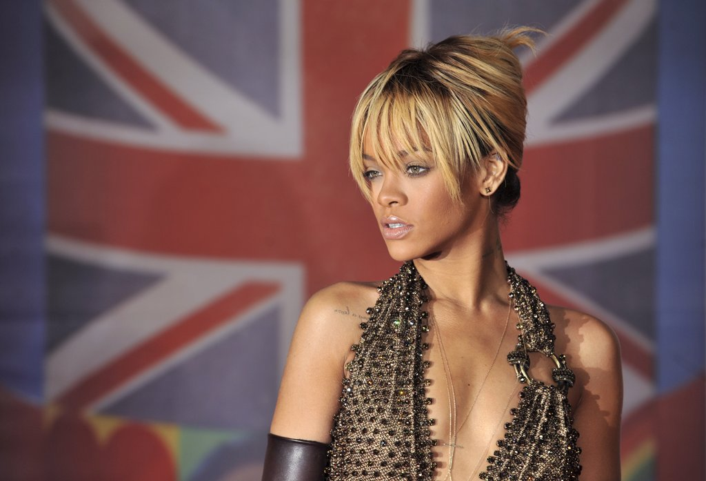 Rihanna wore her blond locks pulled back but left her bold bangs down.