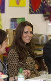 Kate Middleton smiled while visiting an Oxford school.