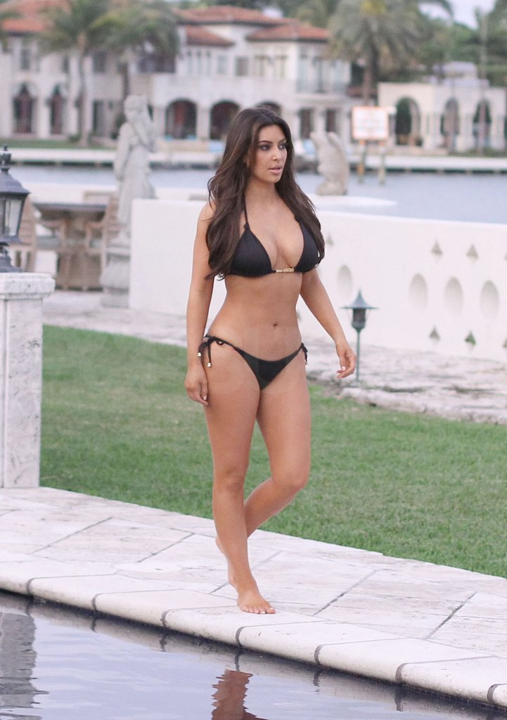 Kim Kardashian wore a black bikini by a Miami pool.