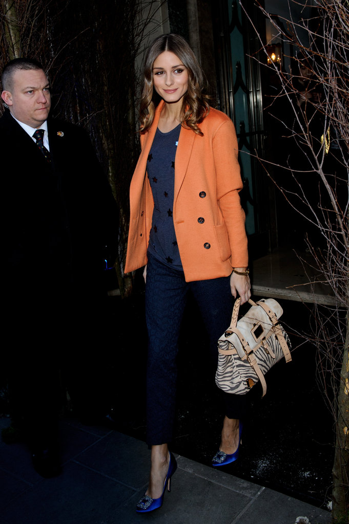 Color-mixing and all, Olivia pulls together a sophisticated jacket and trousers with luxe Manolos and a statement satchel by Mulberry while attending London Fashion Week.  4761856