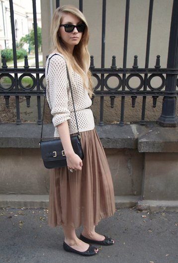 Play to the easiness of a pleated skirt with pieces that are just as effortless to pull together. This look has a total '70s vibe, thanks to an open-knit sweater and long-strap purse.  4775655 Photo courtesy of Lookbook.nu
