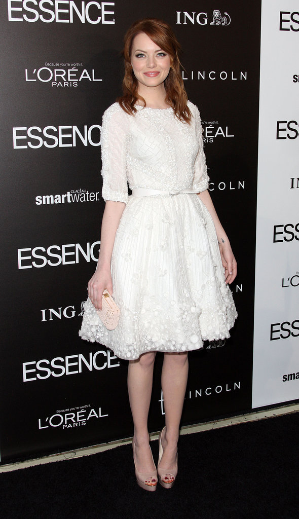 Emma Stone wearing a white dress.