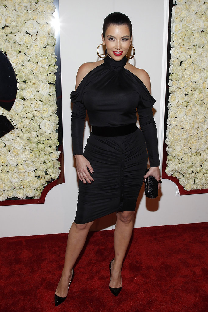 Kim Kardashian donned a black dress for a QVC party.