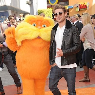 Zac Efron Drops Condom at The Lorax Premiere